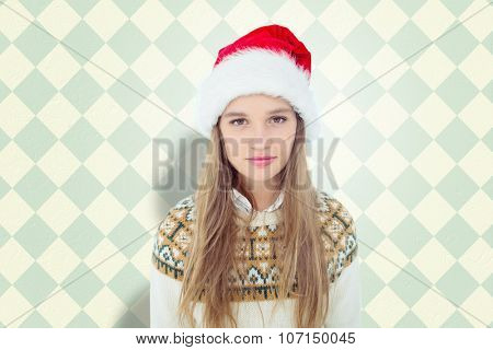 Hipster looking at camera against blue and cream patterned wallpaper