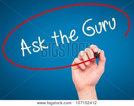 Man Hand writing Ask the Guru with black marker on visual screen.