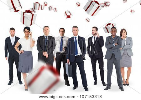 Business team against white and red gift box