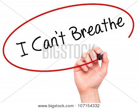 Man Hand writing I Can't Breathe with black marker on visual screen.