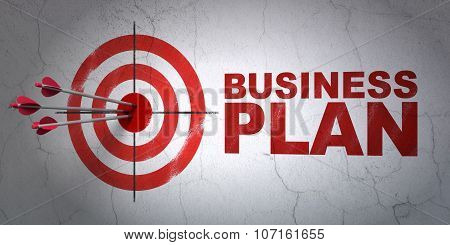 Business concept: target and Business Plan on wall background