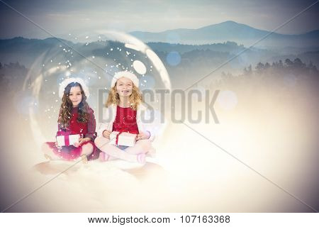 Festive child in snow globe against misty forest