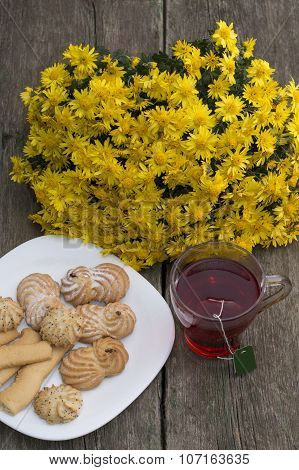 Glass Of Tea, Bouquet Of Yellow Flowers And Plate With Cookies