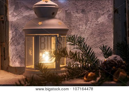 Christmas - candles glow in the steamy window