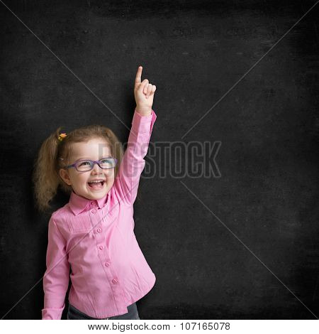 kid in glasses on school chalkboard or blackboard background