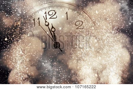 New Year's at midnight - Old clock with stars snowflakes and fireworks
