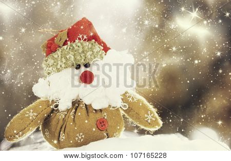 Christmas decoration with closeup on green Santa Claus figurine in the snow