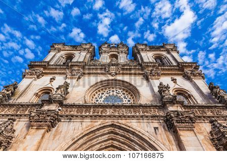 Portugal. Clock on the facade of the Catholic Cathedral .