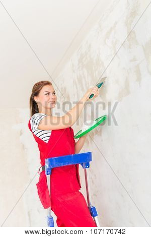 Woman Plastering Wall