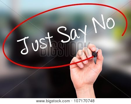 Man Hand writing Just Say No with black marker on visual screen.