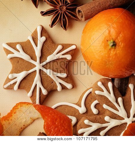 homemade christmas gingerbread cookies on wooden background