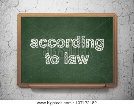 Law concept: According To Law on chalkboard background