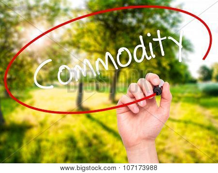 Man Hand writing Commodity with black marker on visual screen