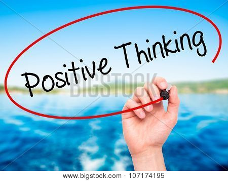 Man Hand writing Positive Thinking with black marker on visual screen