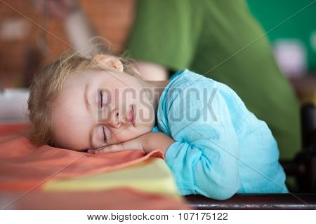 Little Girl Tired And Fall Asleep In Cafe