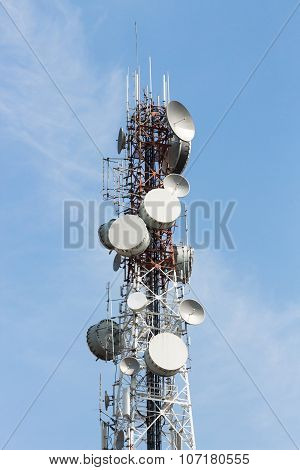 Telecom Satellite Dish Tower On Blue Sky