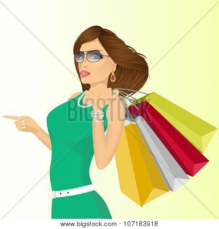 young haughty woman with shopping bags