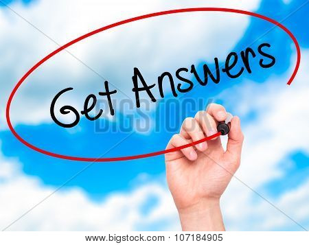 Man Hand writing Get Answers with black marker on visual screen.