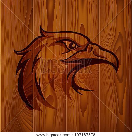 Eagle head vintage logo on realistic brown wood boards texture background