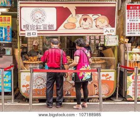 Red Bean Cake Vendors And Shoppers At Danshui Shopping Area