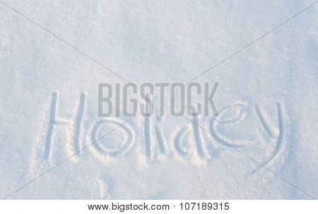 The word Holiday draw on snow