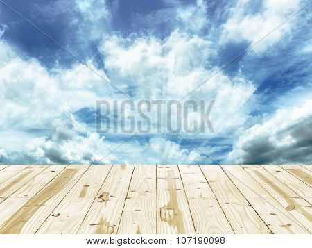 Wood table and Radial blurred in blue sky backgrounds.