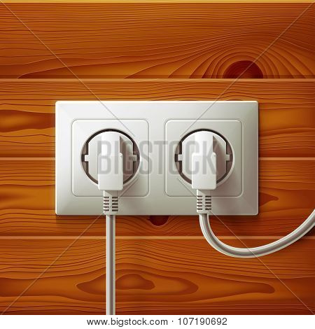 Realistic electric double white socket and two plugs on brown wood boards texture background