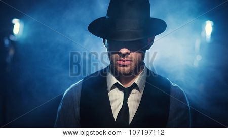 Man In A Hat On A Dark Background