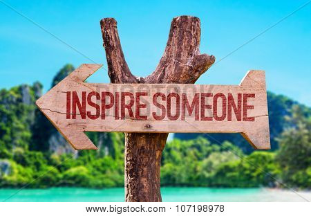 Inspire Someone arrow with beach background