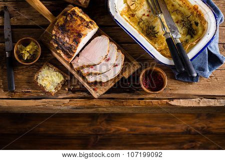 Roasted Pork Loin On The Old Wooden Table