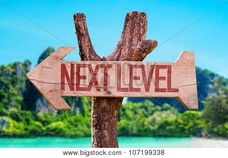 Next Level arrow with beach background