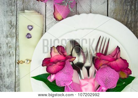 Holiday romantic table setting with pink roses on a white background