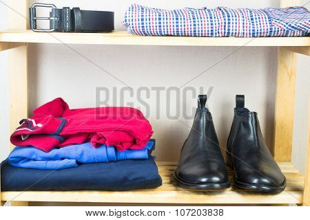 Men's clothes on the shelf