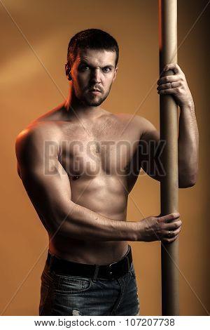 Muscular Man With Crossbar