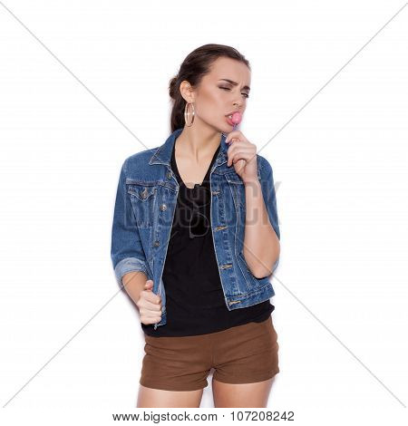 Fashion Girl Wearing Blue Jeans Jacket Licking Candy