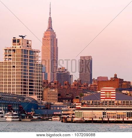 The skyline of New York City at sunset seen from the piers at the Hudson river