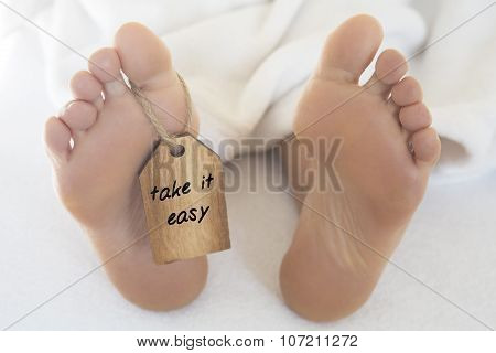 Naked Feet  With Wooden Tag 'take It Easy