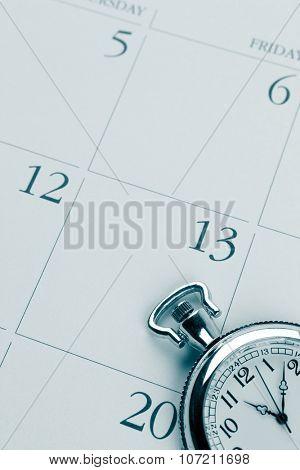 Closeup of watch on calendar