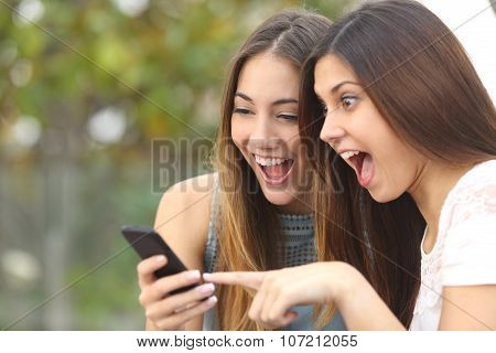 Euphoric Friends Watching Videos On A Smartphone