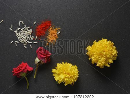 Marigold flowers, rose and kumkum tilak. Indian religious festive background.