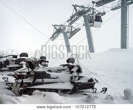 Snowmobiles On Parking In Mountains