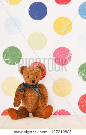 vintage bear in colorful nursery room
