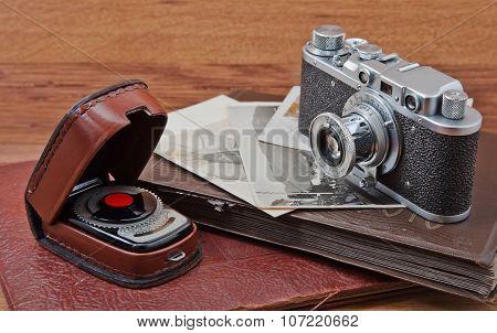 vintage camera, photo album and light meter