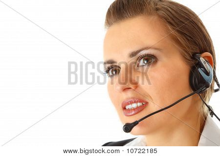 Thoughtful modern business female with headset