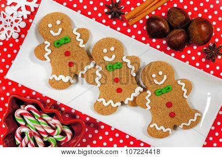 Christmas gingerbread man cookies with red polka dot background