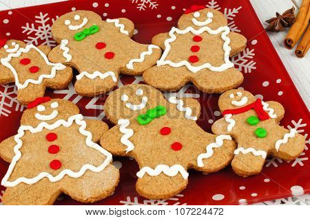 Christmas gingerbread man cookies on festive red plate