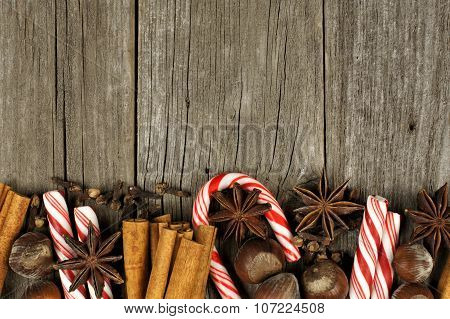 Christmas baking goods and candies border over rustic wood
