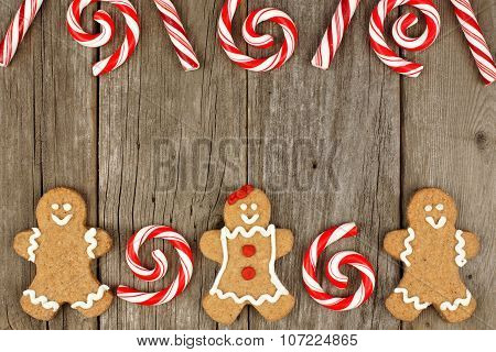 Christmas gingerbread cookies and peppermints on rustic wood