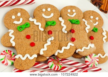 Christmas gingerbread man cookies on plate with candy