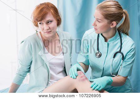 Doctor Diagnosing Female Patient